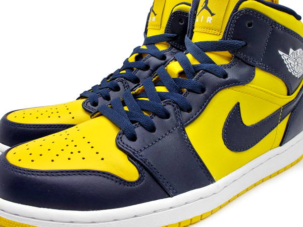 4b853a18d23 Arriving as part of the off-court collection for Marquette University next  year is this Air Jordan 1 Phat colorway