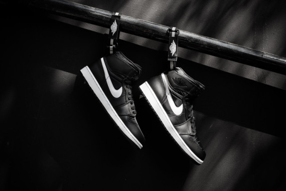 No nonsense is the name of the game with the air jordan 1 high strap seen here in its latest colorway of black white true to past releases of the shoe