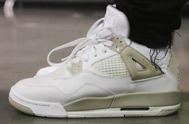 white and tan jordan 4