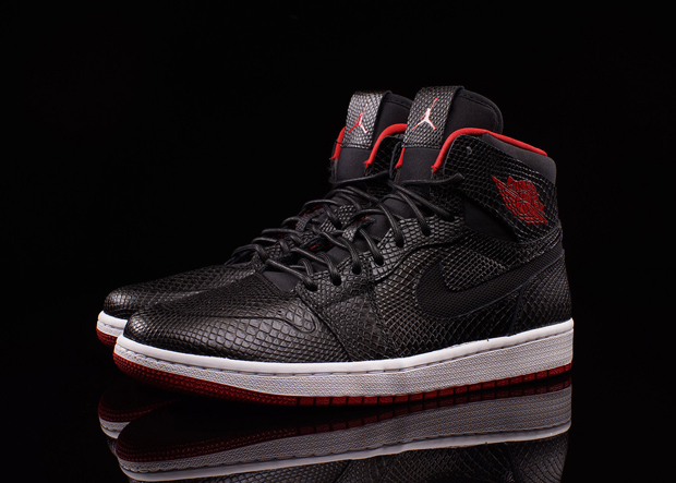 """8b422d552f Not much of a wait for the """"Bred"""" Air Jordan 1 Nouveau. Fans of this newly  previewed luxe edition – plied with debossed snakeskin detailing on par  with the ..."""