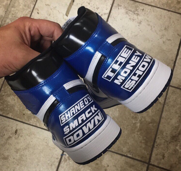 "cf96d48e8b60 The sneaker artist whipped up this pair of ""WWE Draft"" custom Air Jordan 1  for Shane...Read More"