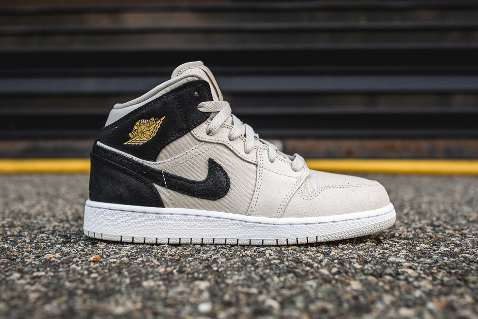 """brand new dee05 ab512 Black History Month has come and gone, but the traditional black and gold  sneaker styling of that period carries on for spring. Air Jordan 1 GS  """"Light Bone"""" ..."""